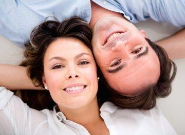 couple laying on ground | dentist charlotte