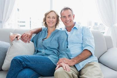 Man and woman cuddling on couch | Dentist 28210