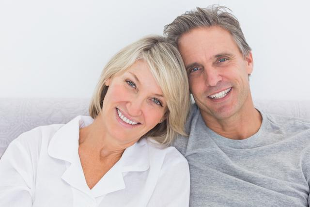 Man and woman snuggling and smiling | Dentist 28210