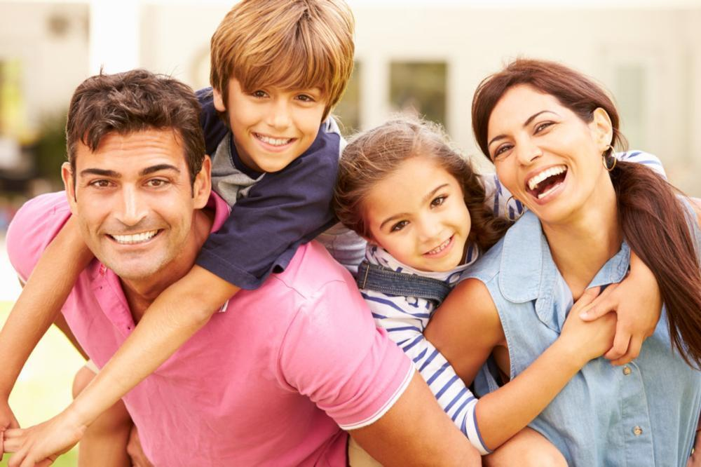 Hugging Family | Charlotte NC Dentist